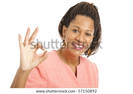 Beautiful African-American businesswoman giving the okay sign. - stock photo