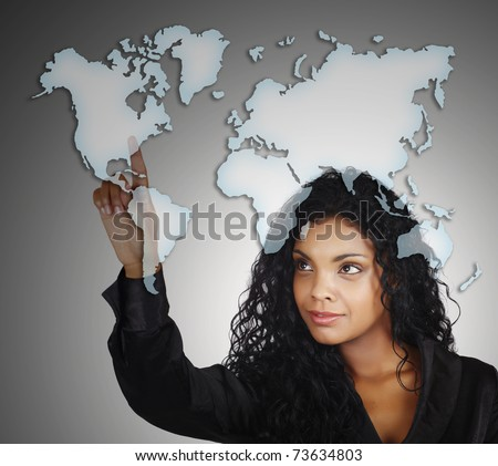beautiful African AMerican businesswoman pointing at the North America on the drawing of the map of the world with a positive attitude. - stock photo