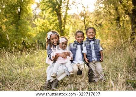 Beautiful African American Children Portrait Outdoors - stock photo