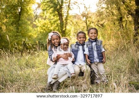Beautiful African American Children Portrait Outdoors - stock photo