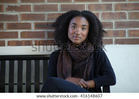 Beautiful African american girl looking to camera, model, adult, student girl, smiling, yong black girl, happy, united states, american girl, native, cute female, college, african student, people - stock photo