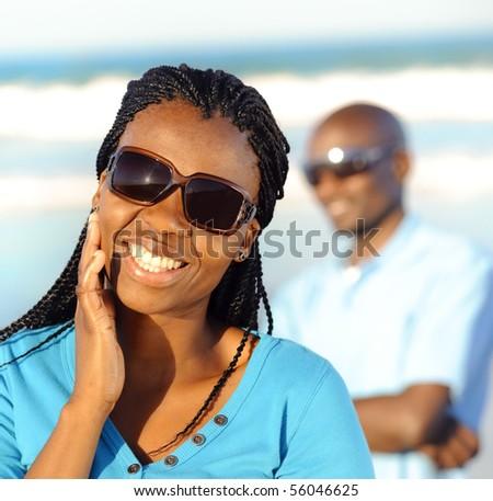 Beautiful African American girl looks towards camera - stock photo