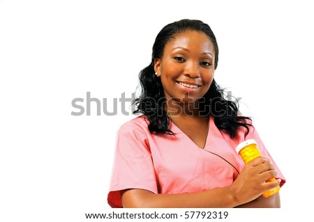 Beautiful African American healthcare professional in pink scrubs - holding pill bottle - stock photo
