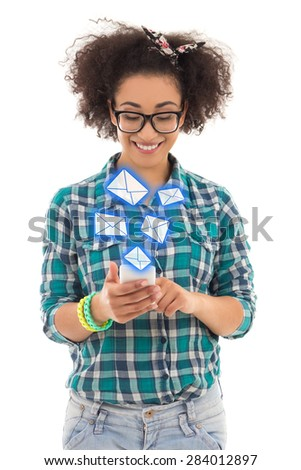 beautiful african american teenage girl sending sms messages with mobile phone isolated on white background - stock photo