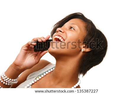 Beautiful African American teenage girl talking on cell phone, isolated on white. - stock photo