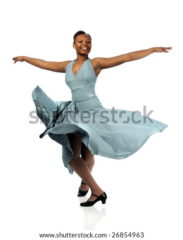 Beautiful African American woman dancing with dress blowing over white background - stock photo