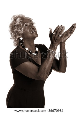 Beautiful african-american woman raising her hands in praise. - stock photo