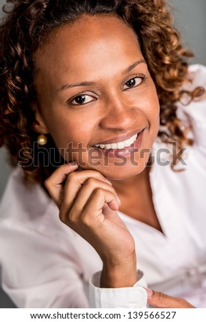 Beautiful African American woman smiling and looking happy - stock photo