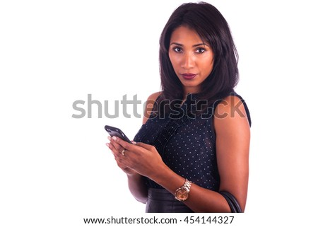 Beautiful African American woman talking on cell phone, isolated - stock photo