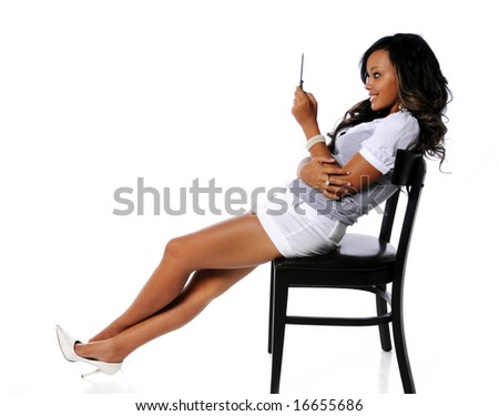 Beautiful African American woman using cell phone - stock photo