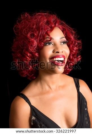 Beautiful african american woman with stylish red hair - stock photo