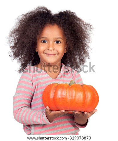 Beautiful african child with a big pumpkin for Halloween isolated on white - stock photo