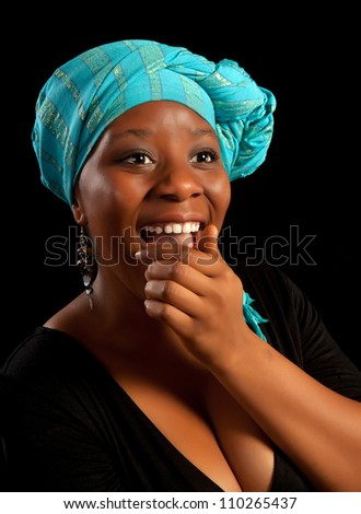 Beautiful african ghanese girl laughing out loud - stock photo