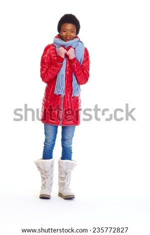 Beautiful african girl in winter coat isolated white background - stock photo