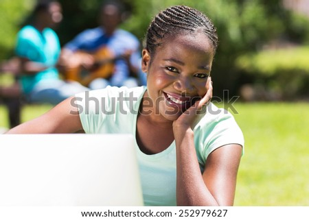beautiful african university student with a computer - stock photo