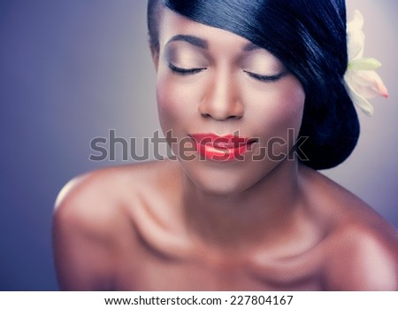 Beautiful african woman with healthy silky hair posing with her eyes closed. - stock photo