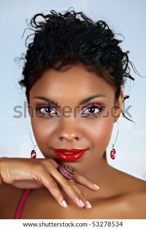 beautiful African woman with red lips and pink eyeshadow, black curly hair pulled back - stock photo