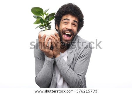 Beautiful afro man with plant - stock photo