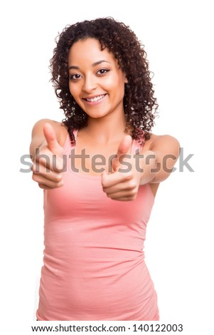 Beautiful afro woman showing thumb up over white background - stock photo
