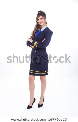 Beautiful air hostess with arms crossed isolated on white background - stock photo