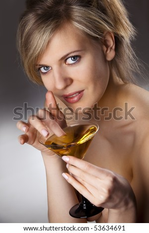 Beautiful alluring woman with glass of cocktail - stock photo