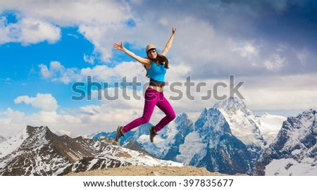 Beautiful amazing day autumn mountains. A woman jump a sport hike in holidays. Nature background. Northern country Russia Caucasus.  - stock photo