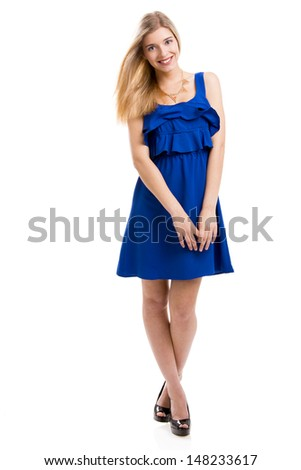 Beautiful and attractive fashion woman wearing a blue dress, isolated over white background - stock photo