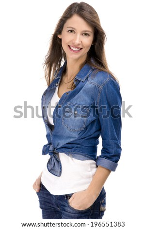 Beautiful and attractive woman wearing  a jeans shirt, isolated over white background - stock photo
