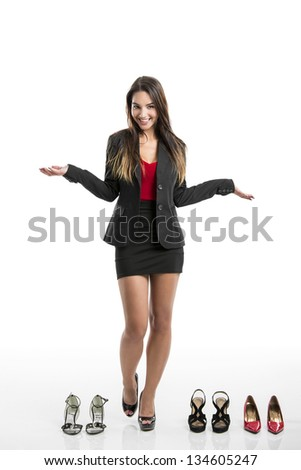 Beautiful and attractive woman with a shoes addiction, isolated over white background - stock photo