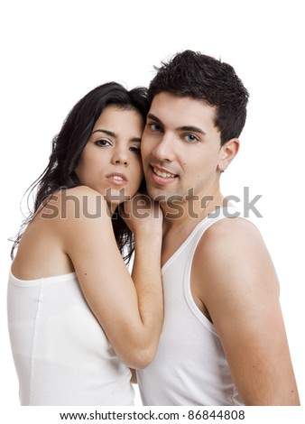 Beautiful and attractive young couple standing over a white background - stock photo
