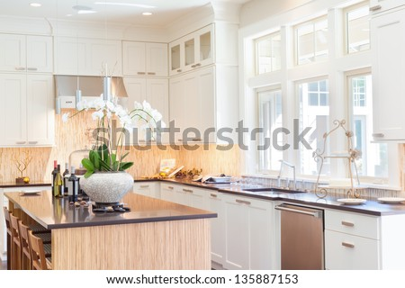 Beautiful and Bright Kitchen in New Luxury Home - stock photo