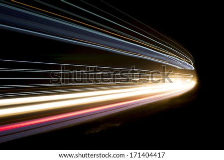 Beautiful and colorful abstract lights in a car tunnel - stock photo