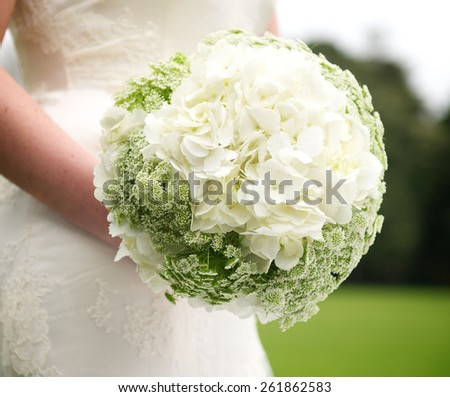 Beautiful and colourful bouquet of flowers on bride�´s hands - stock photo