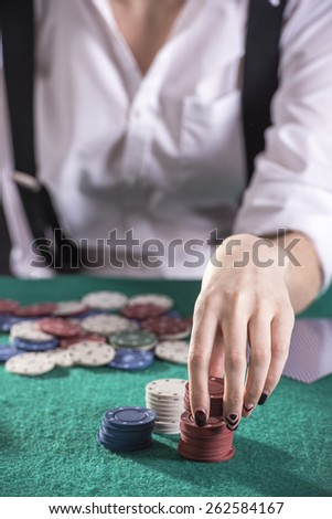 Beautiful and dangerous. Young female gangster play poker. isolated on dark background. - stock photo