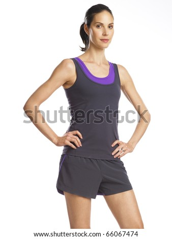 Beautiful and determined young woman ready for sports - stock photo