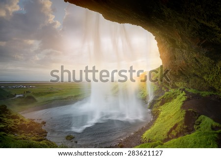Beautiful and dramatic sunset in Seljalandsfoss waterfalls, Iceland - stock photo