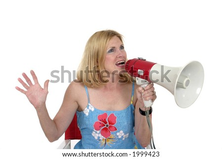 Beautiful and glamorous woman sitting in red director's chair holding a megaphone.  Shot isolated on white. - stock photo