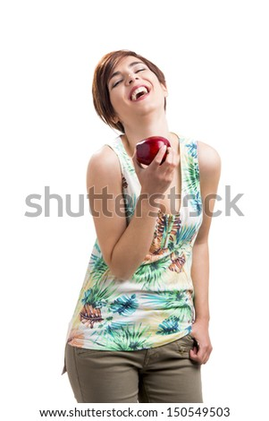 Beautiful and happy woman with a red apple, isolated over white background - stock photo