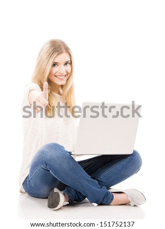 Beautiful and happy woman working on a laptop with thumbs up, isolated over white background - stock photo