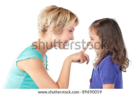 beautiful and happy young mother and small daughter smiling and looking at each other. Mother pushing daughter on nose with her finger. Studio shot, isolated on white background - stock photo