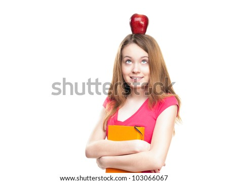 Beautiful and happy young student girl with apple on her head and book in her hands. Looking up and thinking. Isolated on white background. - stock photo