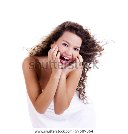 Beautiful and happy young woman isolated on white - stock photo