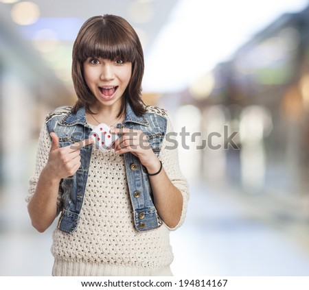 beautiful and happy young woman marking a dice - stock photo