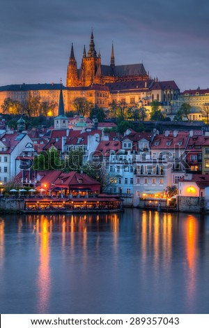 beautiful and historic Charles Bridge with castle in background at dusk in Prague, Czech Republic - stock photo