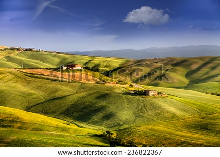 Beautiful and miraculous colors of green spring landscape of Tuscany, Italy. - stock photo