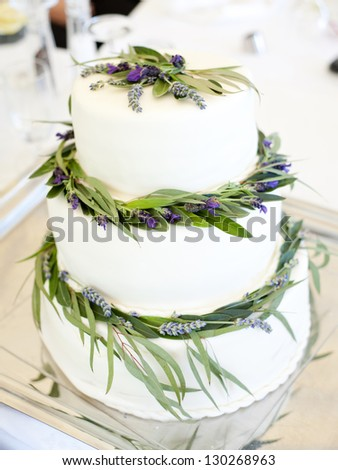 Beautiful and natural lavender wedding cake - stock photo