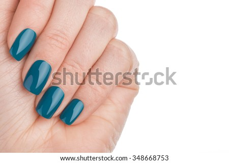 Beautiful and neat nails green closeup. - stock photo