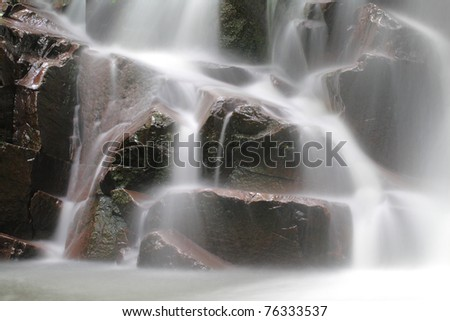 Beautiful and peaceful waterfall in the nature - stock photo