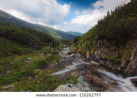 Beautiful and pristine stream in the mountains - stock photo