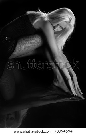 beautiful and sexy blonde on a black background - stock photo